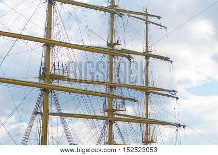 The big Old sailing boat rigging on the background sky