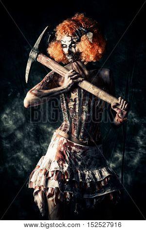 Evil clown murderer stained in blood. Female zombie clown. Halloween. Horror. poster