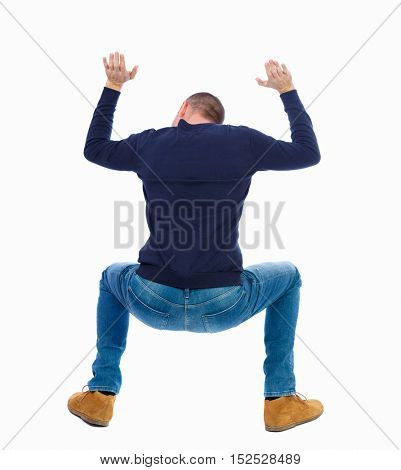 back view. man  protects hands from what is falling from above. Man holding a heavy load Rear view people collection.   Isolated over white background. Man in warm jacket sat under a big weight.