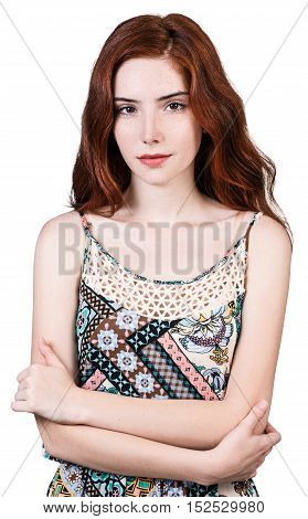 Beautiful redhead woman with crossed hands isolated on white background