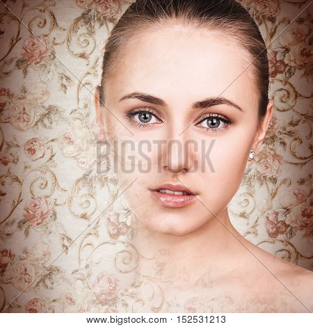 Beautiful young woman posing over wallpaper background
