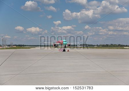 Borispol Ukraine - July 5 2014: WINDROSE Airbus A321 is taxiing along the airfield to the runway for takeoff