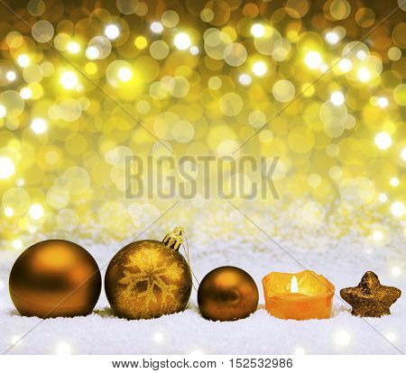 Christmas golden decoration with snow isolated on bokeh background.Defocused bokeh lights.