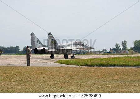 Vasilkov Ukraine - August 3 2012: Ukrainian Air Force Mig-29 fighter plane in gray paintscheme is taxiing to the runway for takeoff
