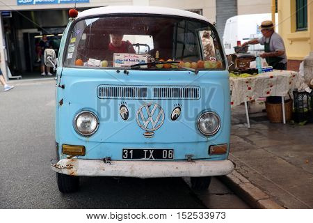 Menton France - May 14 2016: Blue Vintage Minibus Volkswagen Type 2 Van at the City Street in Menton French Riviera