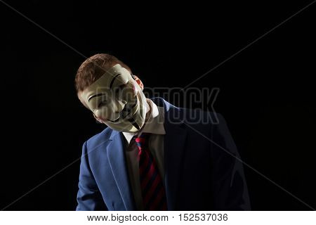 London - UK - 19 October 2016 - Businessman wearing a hacker mask. This mask is a well-known symbol for the online hacktivist group Anonymous