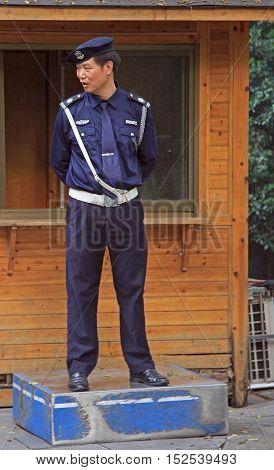 Hangzhou China - June 29 2016: police officer is standing outdoor in Hangzhou China