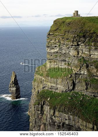 View of Cliffs of moher, Irlanda with castle