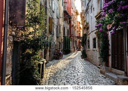 Rovinj, Croatia - July, 2016 - street with people in the center of the historic European city Rovinj in Croatia at sunset.