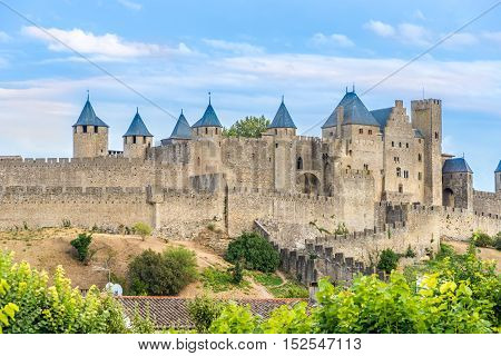 CARCASSONNE,FRANCE - AUGUST 29,2016 - Carcassonne is a fortified French town in the Aude department.The fortified city itself consists essentially of a concentric design of two outer walls with 53 towers and barbicans