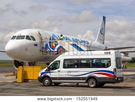 Simferopol, Russia - June 15, 2016: The car brought business class passengers to the plane