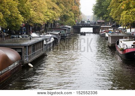 Houseboats on a rainy day in the canals of Amsterdam