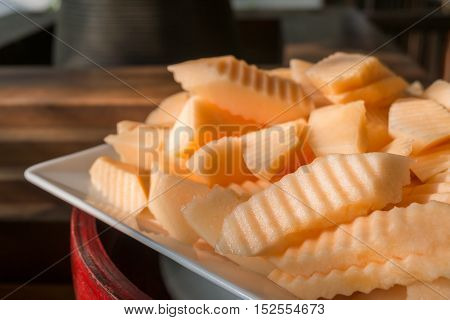 Close up slice of fresh cantaloupe in the morning