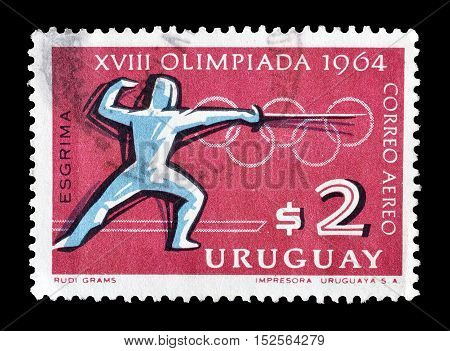 URUGUAY - CIRCA 1964 : Cancelled postage stamp printed by Uruguay, that shows Fencing.