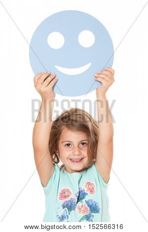 Little girl holding abstract smiling face