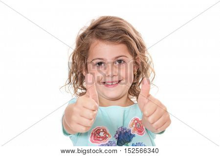 Little girl showing thumbs up. All on white background.