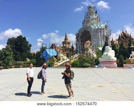 CHIANG RAI THAILAND - OCTOBER 18 : three unidentified people walking to Sang Kaew Temple on October 18 2016 in Chiang rai Thailand.
