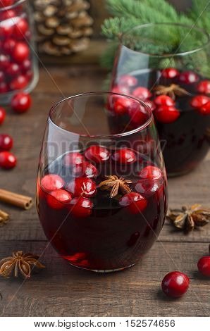 Mulled red wine in a glass on a wooden table, selective focus