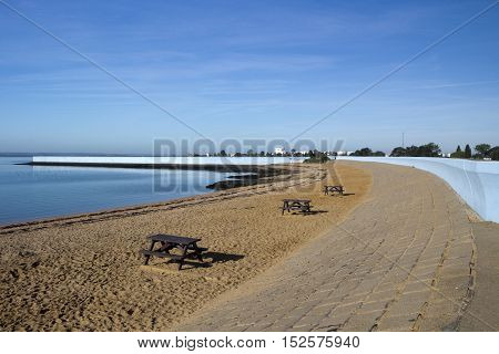 Beach and sea wall at Thorney Bay Canvey Island Essex England