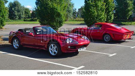 ST NEOTS, CAMBRIDGESHIRE, ENGLAND - SEPTEMBER 11, 2016: Classic Red 1999 Marcos Mantara Sports car.