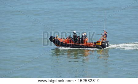 FELIXSTOWE, SUFFOLK, ENGLAND, AUGUST 29, 2016: RNLI Inshore rescue boat and crew at Felixstowe