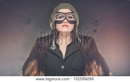 Woman soldier in World War II uniform. Standing in smoke in old elevator.
