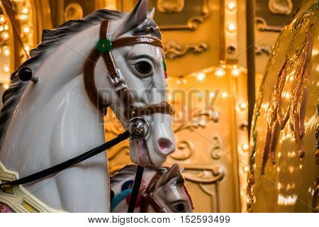 Carousel ride with painted horses for fun experience -merry go round.