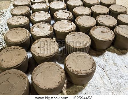 Raw clay is a material used to make pottery.