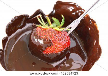 strawberry and dark chocolate fondue on white background