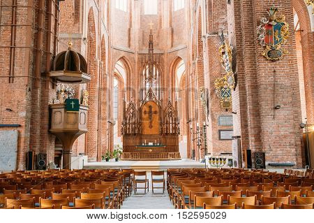 Riga, Latvia - July 1, 2016: The Nave Of St. Peter's Church Interior, The Central Part Of Church Building For Parishioners Accommodation.