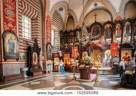 Vilnius, Lithuania - July 04, 2016: The Iconostasis And Church Interior Of Christian Orthodox Church Of Saint Nicholas With Parishioners.