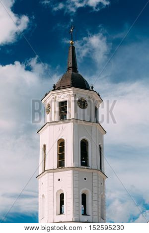 Vilnius, Lithuania. Close Up Of Bell Tower Near Cathedral Basilica Of St. Stanislaus And St. Vladislav In Summer Sunny Day,  Blue Cloudy Sky Background. Roman Catholic Cathedral At The Cathedral Square.