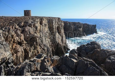 View on the tower of Cala Domestica in Sardinia Italy.