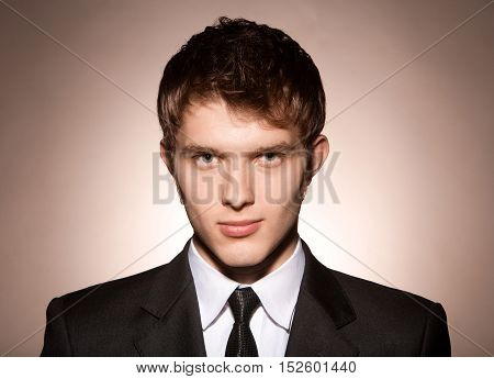 young business man on a beige background