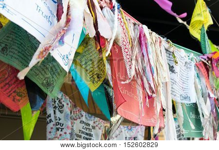 Festival banners, handkerchiefs, and fabric ribbons on hanging lines - festival celebration