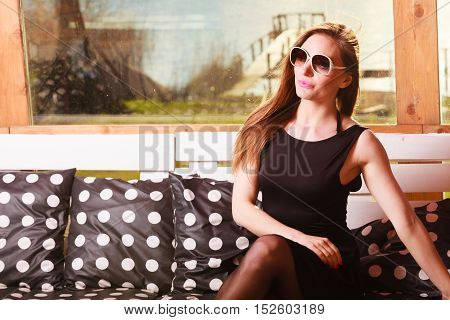 Young Sexy Woman Posing On Bench.