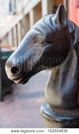 French Quarter, New Orleans, Louisiana street art- hitching post replica in shopping district