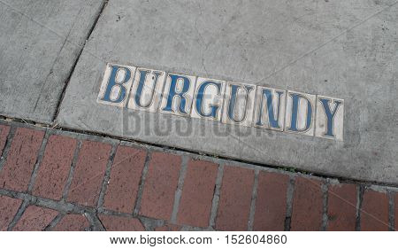 Sidewalk text markers on city street in New Orleans, Louisiana, USA