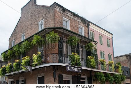 French Quarter architecture in New Orleans Louisiana - three story building from 1800's.