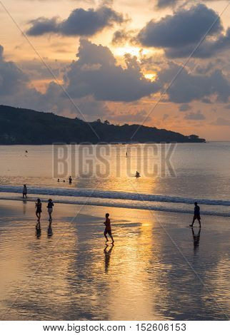 Sunset at Jimbaran Beach in Bali, Indonesia.