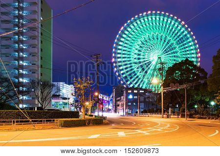 Tempozan ferris wheel at night with cityscape