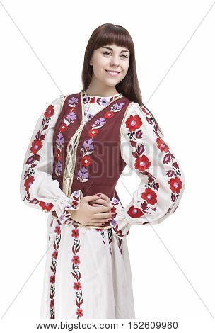 Portrait of Happy Smiling Brunette Woman Posing in Unique Hand-Made Flowery National Costume Dress. Against Pure White Background. Vertical Shot