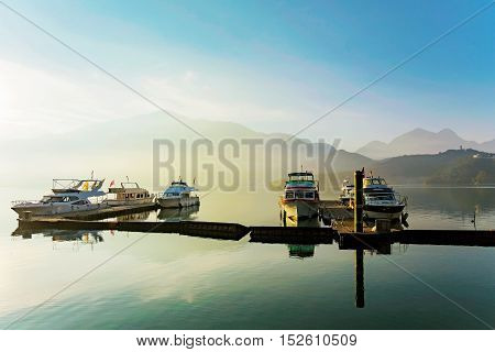 Boats on sun moon lake during sunrise