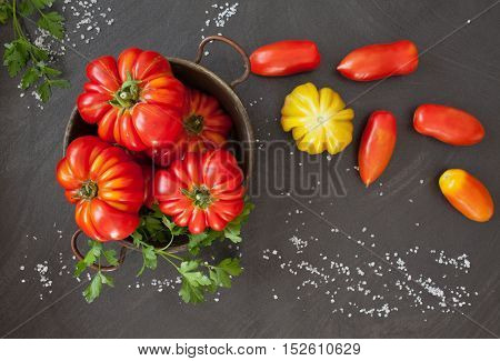 Fresh tomatoes, two varieties: Heirloom and oblong type.