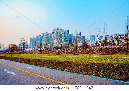 cycling path with buildings nearby the Han river in Seoul