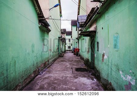 dismal side street in ancient Chinese town in Shanghai