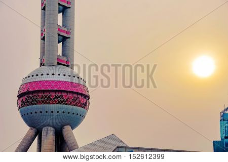 SHANGHAI - MARCH 20: Close up detail photograph of the Oriental Pearl Tower with the sunset in the background on March 20 2016 in Shanghai.