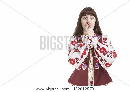 Portrait of Frightened Caucasian Brunette Female. Posing with Hands Closing Mouth. Against Pure White. Horizontal Image Orientation