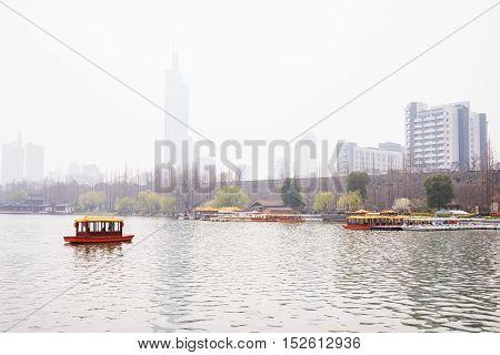 Foggy scene of a boat on the lake in Nanjing China