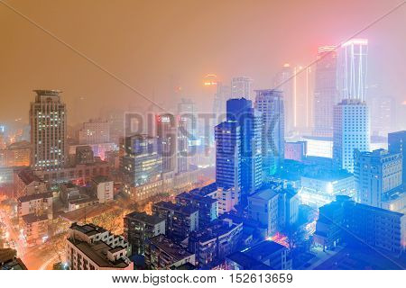 NANJING CHINA - MARCH 18: Downtown Nanjing Xinjiekou financial district. This is the central downtown area of Nanjing at night time on March 18 2016 in Nanjing.